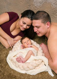 Young family. Young parents admiring their seven days old newborn baby Royalty Free Stock Photo