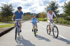 Young Family Parents and Boy Son Cycling Royalty Free Stock Images
