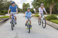 Young Family Parents and Boy Son Cycling Royalty Free Stock Image