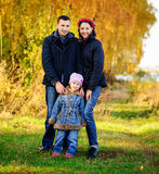 Young family, parents with small children in golden autumn city park stock photography