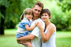 Young Family in Park. Young Family Bonding in Park stock photography