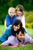 Young Family in Park Stock Photos