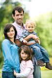 Young Family in Park Royalty Free Stock Photos