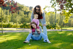 Young family in a park Stock Photo