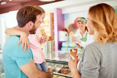 Young family at pastry shop royalty free stock photos