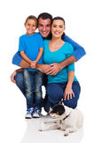 Young family pet. Cheerful young family with pet dog isolated on white Royalty Free Stock Images