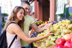 Young family picking fruits Royalty Free Stock Photography