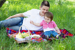 Young family on a picnic Royalty Free Stock Image