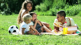 Young family with picnic Stock Photo