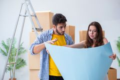 The young family planning home refurbishing in diy concept Stock Photo