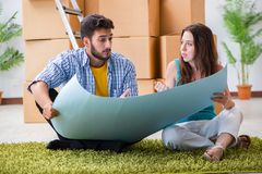 The young family planning home refurbishing in diy concept royalty free stock photography