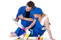 Young family plans repair of a children's room. Stock Image