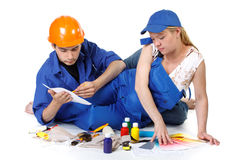 Young family plans repair of a children's room. Stock Photos