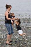 Young family playing at beach Royalty Free Stock Photography