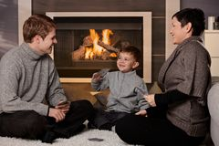 Young family playing card game. Young family with 4 years old kid playing card game at home in a cold winter day Stock Images
