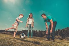 Young family playing football