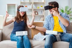 The young family playing games with virtual reality glasses. Young family playing games with virtual reality glasses Stock Photography