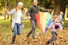Young family playing with a kite Stock Image