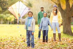 Young family playing with a kite Stock Images