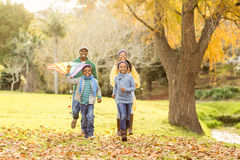 Young family playing with a kite Royalty Free Stock Image