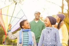 Young family playing with a kite. On an autumns day Stock Photo