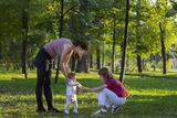 Young family playing with a little baby girl learning to walk Royalty Free Stock Photography