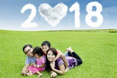 Young family with numbers 2018 Royalty Free Stock Image