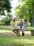 Young family playing in the park Royalty Free Stock Photo
