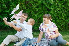 Young family playing on a picnic in the summer park Royalty Free Stock Images