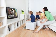 Young family playing videogames stock images
