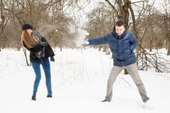 The young family plays winter wood on snow Royalty Free Stock Photography