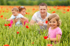Young family in poppy field Stock Photography