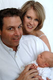 Young family portrait. Parents holding thier newborn baby Royalty Free Stock Photography