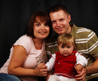 Young family portrait. With addorable baby girl Stock Photography