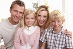 Young family pose together royalty free stock images