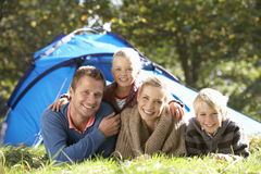 Young family poses outside of tent stock photography