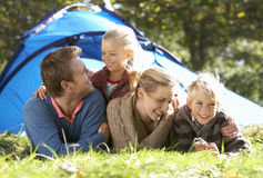 Young family poses outside of tent Stock Photo