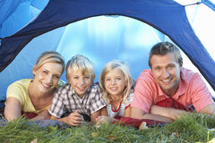 Young family poses in tent Royalty Free Stock Photos