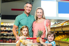 Young Family posing together with trolley Stock Image