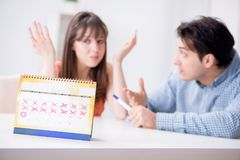 Young family in pregnancy planning concept with ovulation calend. Ar stock photos