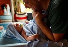 Young family - Proud father with his baby son. Young family - Proud father with his cute baby son royalty free stock image