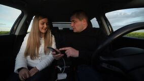 A young family quarrels in a car