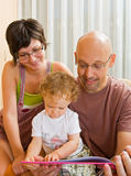 Young family reading Stock Photography