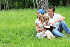 Young family reading the Bible Royalty Free Stock Photography