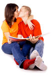 Young family reading a book together Stock Photos