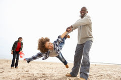 Young Family Relaxing On Beach Camping Holiday. Having Fun stock photo