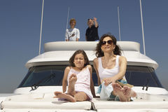 Young family relaxing on boat Royalty Free Stock Photos