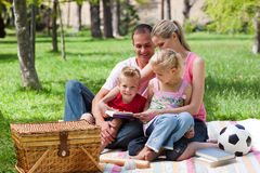 Young family relaxing while having a picnic Stock Images