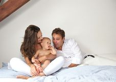 Young family relaxing at home with baby stock image