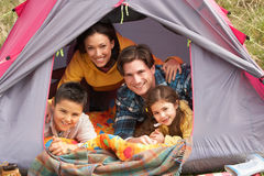 Young Family Relaxing Inside Tent stock images